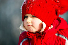 Cute little girl playing with snow Stock Photo