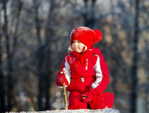 Cute little girl playing with snow Royalty Free Stock Photography
