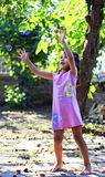 Cute little girl playing soap bubbles in the yard Stock Images