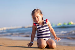 Cute little girl playing on summer beach Royalty Free Stock Images