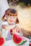 Cute little girl playing in summer park. Outdoor Stock Image