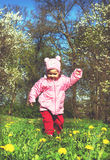 Cute little girl is playing in sunny day Royalty Free Stock Images