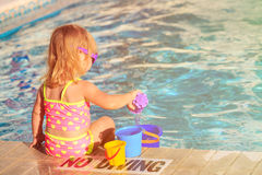Cute little girl playing in swimming pool at beach Royalty Free Stock Photo