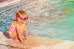 Cute little girl playing in swimming pool at beach Royalty Free Stock Photography