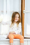 Cute little girl playing with toilet paper roll Royalty Free Stock Photos