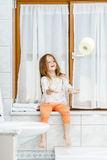 Cute little girl playing with toilet paper roll Stock Photo
