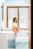 Cute little girl playing with toilet paper roll Stock Photography