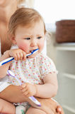 Cute little girl playing with toothbrush Royalty Free Stock Photo
