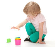 Cute little girl playing with toys Royalty Free Stock Photography
