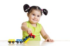 Cute little girl playing trains Stock Photography
