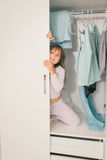 Cute little girl playing in wardrobe Royalty Free Stock Photo