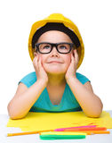 Cute little girl is playing while wearing hard hat Stock Photography