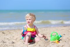 Cute little girl plays on the beach Royalty Free Stock Photography