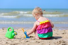 Cute little girl plays on the beach Stock Photography