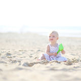 Cute little girl plays on the beach Stock Photo