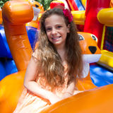 Cute little girl plays in bouncing castle Stock Photography