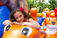 Cute little girl plays in bouncing castle Royalty Free Stock Image