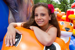 Cute little girl plays in bouncing castle Royalty Free Stock Photography