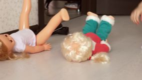 Cute little girl plays with doll`s house stock footage