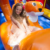 Cute Little Girl Plays In Bouncing Castle Royalty Free Stock Images