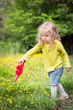 Cute little girl plays Royalty Free Stock Photo