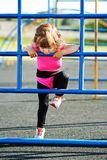 Cute little girl plays on playground Royalty Free Stock Photos
