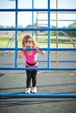 Cute little girl plays on playground Royalty Free Stock Image