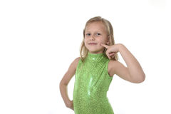 Cute little girl pointing her cheeck in body parts learning school chart serie. 6 or 7 years old little girl with blond hair and blue eyes smiling happy posing Royalty Free Stock Photography