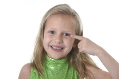 Cute little girl pointing her eye in body parts learning school chart serie Royalty Free Stock Photos
