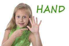 Cute little girl pointing her hand in body parts learning English words at school Royalty Free Stock Photos