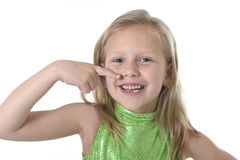 Cute little girl pointing her mouth in body parts learning school chart serie. 6 or 7 years old little girl with blond hair and blue eyes smiling happy posing stock images