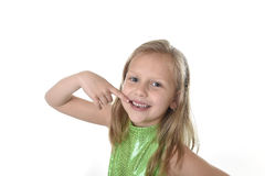 Cute little girl pointing her mouth in body parts learning school chart serie. 6 or 7 years old little girl with blond hair and blue eyes smiling happy posing stock photography