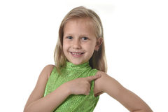 Cute little girl pointing her shoulder in body parts learning school chart serie. 6 or 7 years old little girl with blond hair and blue eyes smiling happy posing stock photo