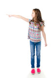 Cute little girl is pointing to the side isolated Royalty Free Stock Photography