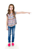 Cute little girl is pointing to the side isolated Stock Photos
