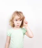 Cute little girl pointing up Stock Images