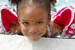 Cute little girl in pool Stock Images