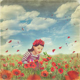 Cute little girl in the poppy field Stock Images