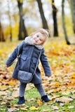 Cute little girl portrait in autumn park Stock Images