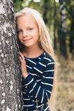 Cute Little girl portrait near tree birch. Stock Image