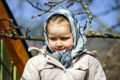 Cute little girl portrait , spring day, playground Royalty Free Stock Photo