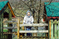 Cute little girl portrait , spring day, playground Royalty Free Stock Photos