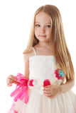 Cute little girl posing in beautiful pink dress Royalty Free Stock Image