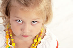 Cute little girl posing  for the camera. And looking up  close-up Royalty Free Stock Photo