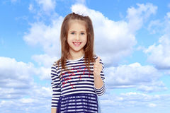 Cute little girl posing in front of the camera. Royalty Free Stock Photos