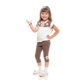 Cute Little Girl Posing In The Studio And Point To Somewhere Or Royalty Free Stock Image
