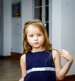 Cute little girl posing indoor Royalty Free Stock Images