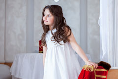 Cute little girl posing looking away from camera Royalty Free Stock Images