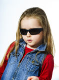 Cute little girl posing in mother's sunglasses, childhood concep Royalty Free Stock Images