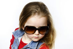 Cute little girl posing in mother's sunglasses, childhood concep Stock Images
